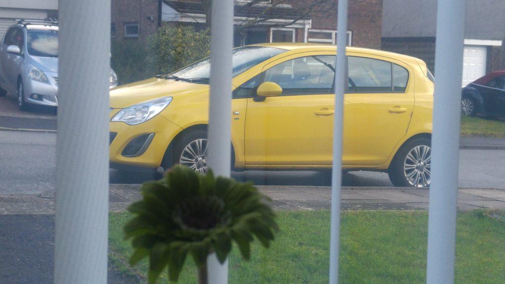 yellow Vauxhall Corsa